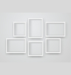 Empty white frames on a wall vector