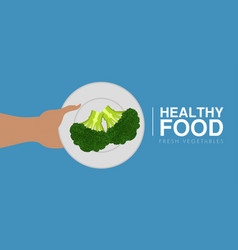 Hand holding a brocoli healthy food concept vector