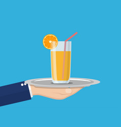 Orange juice in glass cup on tray in hand vector