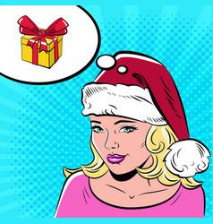 beautiful woman in santa claus hat in the pop art vector image