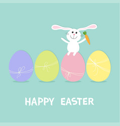 happy easter bunny rabbit with carrot sitting vector image