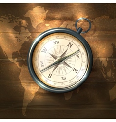 Compass on wooden background vector image