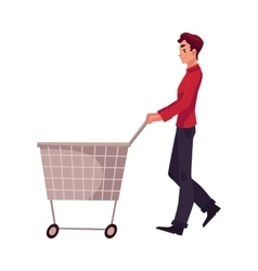 Young man buying products with a shopping cart vector