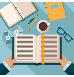Reading books on desktop vector