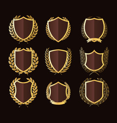 golden shields laurel wreaths badges collection vector image