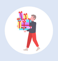 man carrying stack wrapped gift boxes big vector image