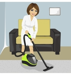 Young woman in white bathrobe cleaning carpet vector