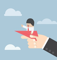 Businessman sitting on paper plane with big hand r vector image vector image