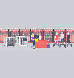 woman customer buying new handbag at cash desk vector image