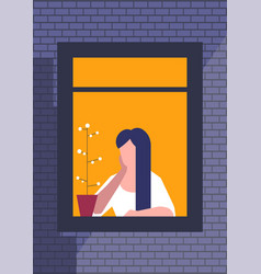 Brunette woman sitting and looking out window vector