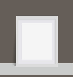 Realistic white photo frame over the wall vector