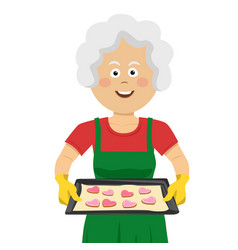 mature lady holding a tray with homemade cookies vector image