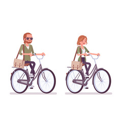 young red-haired man and woman riding a bicycle vector image
