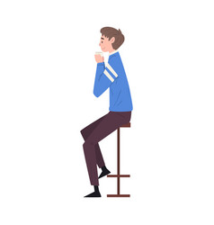 young man sitting on chair at bar drinking coffee vector image