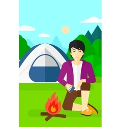 Man kindling fire vector image