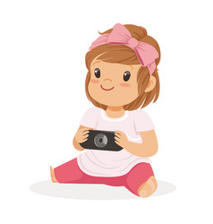 cute little girl sitting on the floor and playing vector image vector image