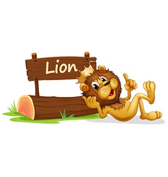 A lion with crown relaxing beside signboard vector