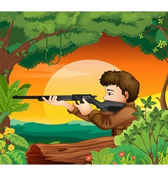 A man with a gun at woods vector