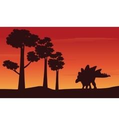 Silhouette of dinosaur stegosaurus on the hill vector