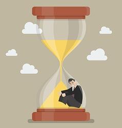 Businessman stuck in sandglass vector image vector image