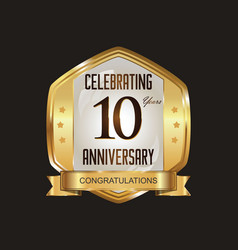 Anniversary golden badge with golden ribbon 10 vector
