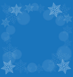 abstract snowflake on blue background vector image