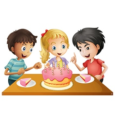 A table with cake surrounded three kids vector