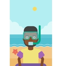 Man with snorkeling equipment on the beach vector
