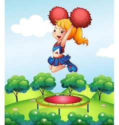 A cheerdancer holding her red pompoms above the vector image vector image