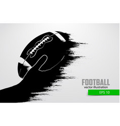 Hand holds the rugby ball silhouette vector