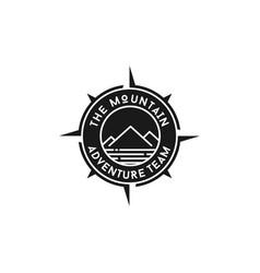 Mountain adventure with compass badge logo design vector