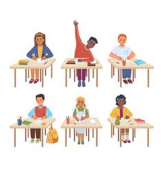 school children sitting at desks listening lesson vector image