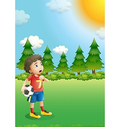 A young football player at the hill vector image vector image