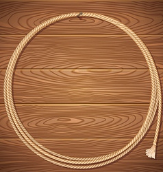 Rope lasso on wood background vector image