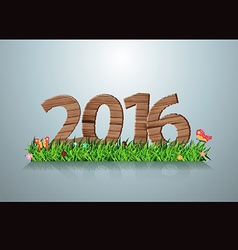 2016 happy new year wooden sign on green grass vector image vector image