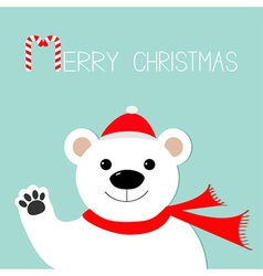 White polar bear in santa claus hat and scarf paw vector image