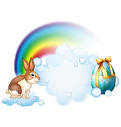 A rabbit and an egg near the rainbow vector image vector image