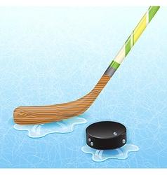 Hockey stick and hockey puck vector image
