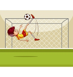 Boy kicking ball in the field vector image vector image
