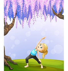 A girl exercising near the giant tree vector image