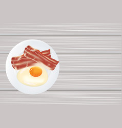 Bacon and egg in the plate on wooden table vector