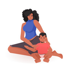 Young african american mother playing with newborn vector