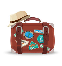retro suitcase with travel stickers and fedora hat vector image