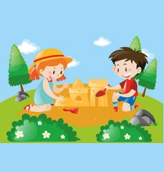 Boy and girl building sandcastle vector