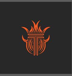 Monogram letter t logo in flames fire heraldic vector