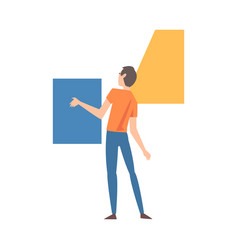 Young man organizing colorful abstract geometric vector