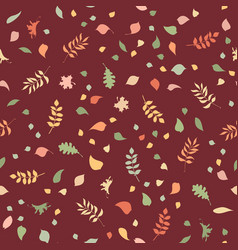 seamless pattern of autumn leaves on dark vector image