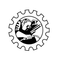 Welder worker welding torch set in gear cog retro vector