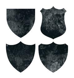 vintage distressed grunge badges or shield vector image