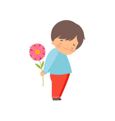 Embarrassed little boy hiding flower behind his vector